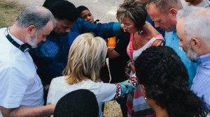 Alex Kendrick, Dr. Tony Evans, Beth Moore, Priscilla Shirer and Stephen Kendrick pray over the Mitchell family and ask God to bless their home in Jesus' name (the Mitchell home served as filming location for the Jordan family). (Courtesy of AFFIRM Films/Provident