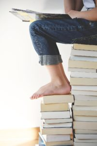 child's foot on books