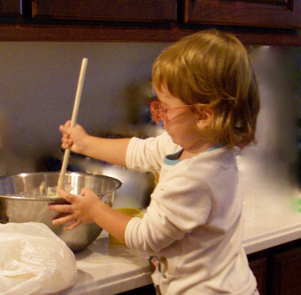 Stirring batter for Christmas Cake