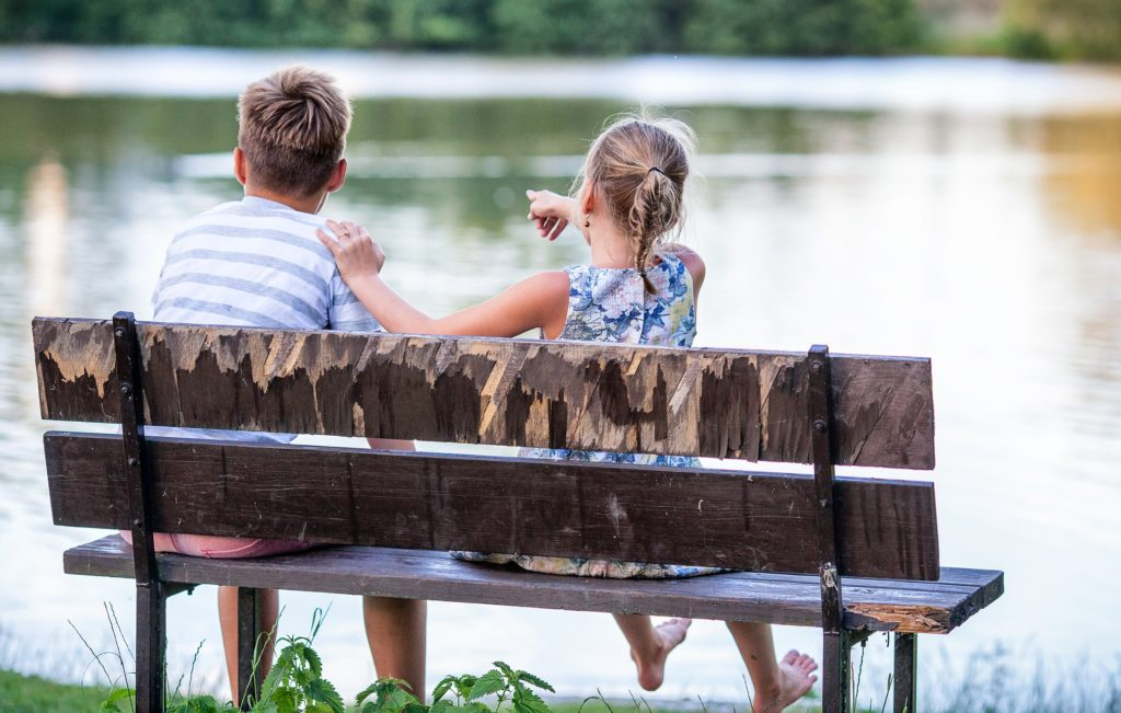 Boy and girl on bench. Look for God's blessings all around you.